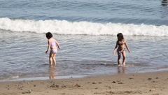 Children play at beach Stock Footage