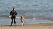 Stock Video Footage of dad and daughter near waves