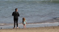 Dad and daughter on beach Stock Footage