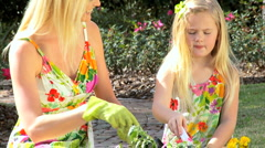 Young Mom & Daughter Working in the Garden Stock Footage