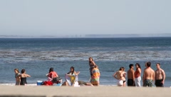 People playing at the beach - stock footage