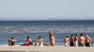 People playing at the beach Stock Footage