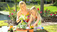 Young Mom & Daughter Gardening Stock Footage