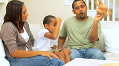 African American Boy Playing at Home with Parents Stock Footage
