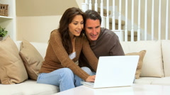 Young Couple Using Laptop Internet Webchat - stock footage