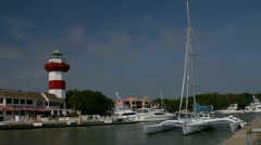 Hilton Head lighthouse seen from Harbour town marina Stock Footage
