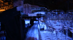 blue bar glasses bartender pours from a bottle - stock footage