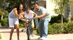 Young African American Boy Riding on his Bicycle Stock Footage