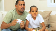 Father & Son Competing on a Games Console - stock footage