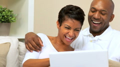 African American Couple Using Laptop at Home Stock Footage