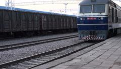 Chinese passenger train arrives at station, railways Stock Footage