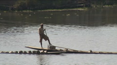 Leg rower carries sand Stock Footage