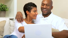 African American Couple Using Laptop at Home - stock footage