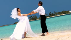 Wedding Couple Laughing & Dancing on the Beach Stock Footage