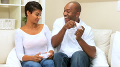 Ethnic Couple Playing with Games Console Stock Footage