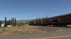 Washington state train cars passing steadily Stock Footage