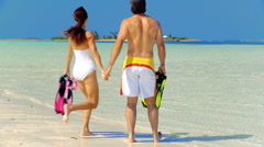 Young Couple Preparing to go Snorkeling Stock Footage
