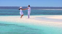 Attractive Couple Enjoying Luxury Island Vacation - stock footage