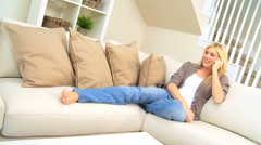 Pretty Girl With Cell Phone Relaxing at Home Stock Footage
