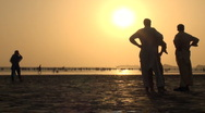 Karachi beach, silhouettes of men and woman, muslims, Islam, Pakistan, sunset Stock Footage