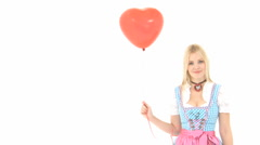 Woman in dirndl with red balloon Stock Footage