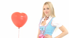 Woman snaps red heart balloon away Stock Footage