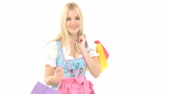 Blonde woman with shopping bags in german dirndl Stock Footage