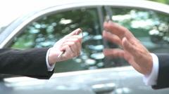 Car key hand over luxury sedan Stock Footage