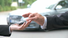 Car key hand over luxury limousine - stock footage