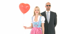 Woman in dirndl with bodyguard Stock Footage