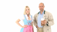 Bavarian couple cheering with a beer mug Stock Footage
