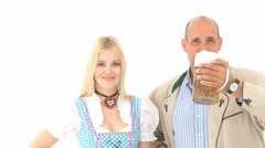 Bavarian couple cheering with a beer mug - stock footage