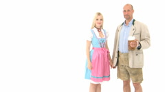 Bavarian couple kiss and cheers Stock Footage