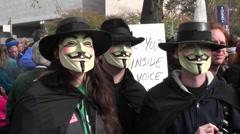 Three masked men posing at the Jon Stewart rally in Washington DC. - stock footage