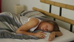 Woman waking up yawning and stretching Stock Footage