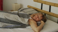Woman In Bed Waking Up At Morning Stock Footage