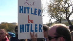 A sign at a political rally says Let Hitler Be Hitler. - stock footage