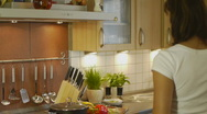 HD1080p25 Attractive woman cooking in the kitchen Stock Footage