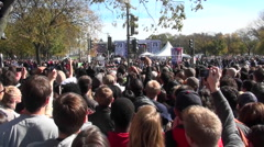 Crowds of protestors on the mall in Washington D.C. do the wave. Stock Footage