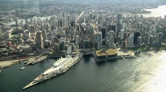 Stock Video Footage of Aerial Downtown Vancouver. Canada Place & waterfront.