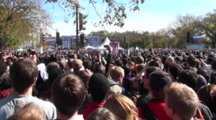 Crowds of protestors on the mall in Washington D.C. do the wave. - stock footage
