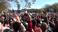 Stock Video Footage of Thousands of protestors applaud en masse on the Washington mall.