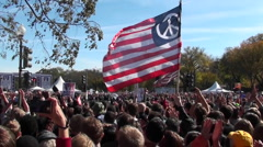 Protestors fly a huge American flag with a peace sign on it in Washington D.C. Stock Footage