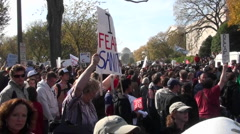Stock Video Footage of Huge crowds walk in a demonstration in Washington D.C.