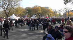 Huge crowds walk in a demonstration in Washington D.C. - stock footage