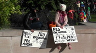 Two girls hold signs saying they are in favor of masturbation, marijuana… Stock Footage