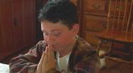 Little Boy Kneeling + Praying 1 Stock Footage