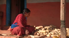 Nepal: Husking Corn Stock Footage