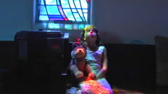 Little Girl Praying By Stained Glass Window 1 - stock footage