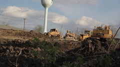 Construction with water tower - earth mover Stock Footage